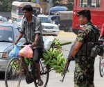 A Sri Lankan soldier looks on as traffic