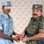 Mr. Pirapaharan awards a TAF airman 2