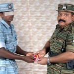 Mr. Pirapaharan awards a TAF airman 3