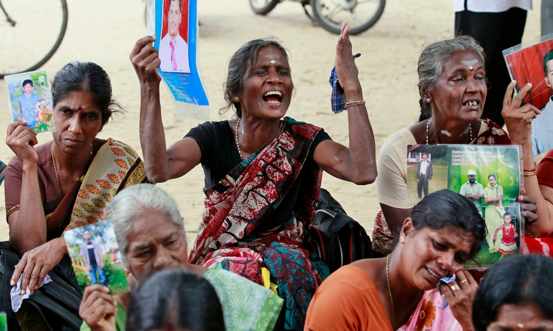 Sri Lankan ethnic Tamil women hold portraits of missing relatives during a protest in Jaffna